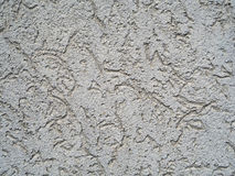 Light beige rough grunge plaster with fissure abstract backgroun Stock Photos