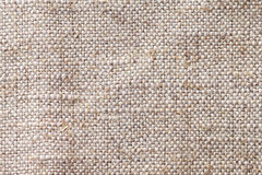 Light beige textile background closeup. Structure of the fabric macro stock photos