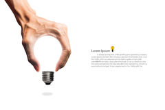 Light blub in hand. On isolated stock photography