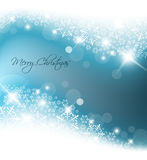 Light blue abstract Christmas background. With white snowflakes Royalty Free Stock Images