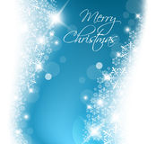 Light blue abstract Christmas background. With white snowflakes Stock Images