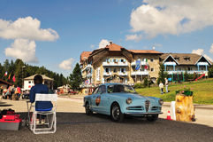 Light blue Alfa Romeo Giulietta Sprint at Passo di Costalunga Royalty Free Stock Photo