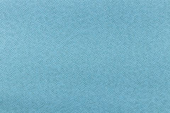 Light blue animal skin pattern made from artificial leather. Texture Royalty Free Stock Photos