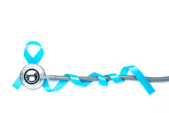 Light blue awareness ribbon and a stethoscope for prostate cance. R awareness campaign and men`s health concept in November and September month royalty free stock photos