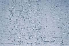 Light blue background of old cracked paint. Pattern of cracked blue paint texture wall background. Blank space. Grey grunge textur. Ed wall abstract background royalty free stock image