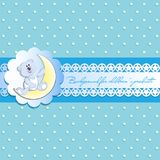 Light blue background with stars. White bear cub on a young month. Vintage background, openwork ribbon with starlets and place for text. Invitation card or Stock Photo