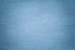Light blue background from a textile material. Fabric with natural texture. Backdrop. Light blue background from a textile material with wicker pattern, closeup royalty free stock image