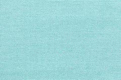 Light blue background from a textile material with wicker pattern, closeup. Royalty Free Stock Image
