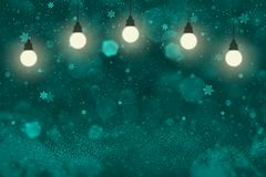Light blue beautiful bright glitter lights defocused bokeh abstract background with light bulbs and falling snow flakes fly, holid. Light blue beautiful glossy royalty free illustration