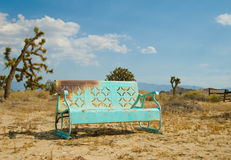 Light Blue Bench Forgotten in the California Deser Royalty Free Stock Photos