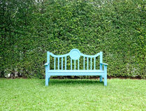 A Light blue bench in garden on leaves background Royalty Free Stock Photo