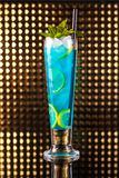 Light blue berry cocktail with lemon in tall royalty free stock image