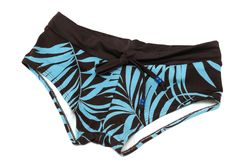 A light blue and black colored ladies swimming shorts with leaf patterns. A photo taken on a light blue and black colored ladies swimming shorts with leaf stock images