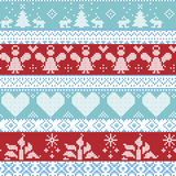 Light blue, blue, white and red Scandinavian Nordic Christmas seamless cross stitch pattern with angels, Xmas trees, rabbits, snow. Flakes, candles, ribbons with Royalty Free Stock Photo