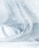 Light blue blurry background with falling snow Stock Image