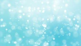 Light blue bokeh background. Beautiful blue glowing bokeh background with floating light particles stock footage