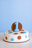 Light blue and brown cake with the #1 Stock Photography