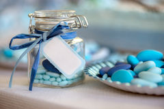 Light blue candy birth. Birth in light blue candy container glass and paper plate Stock Photos