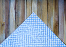 Light Blue Check Napkin on Wood Plank Background Royalty Free Stock Photography
