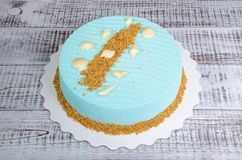 Light blue chocolate velour mousse cake with seashells. A light blue chocolate velour mousse cake with seashells royalty free stock photo
