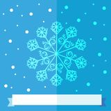 Christmas snow flake over blue background with a white ribbon. A light blue Christmas snowflake flat design illustration on a blue background with snowflakes Stock Photo