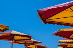 Light blue clear sky and umbrellas Stock Photo