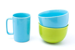 Light blue coffee cup and light blue bowl and green bowl. Isolated with white background. bowls over bowls., bowls pastel tone Royalty Free Stock Images