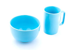 Light blue coffee cup and light blue bowl. Isolated with white background Royalty Free Stock Photos
