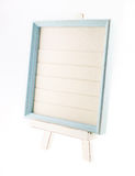 Light blue country rustic style wood frame with canvas on white Stock Images