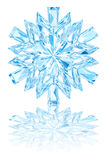 Light blue crystal snowflake on glossy white background Royalty Free Stock Photography