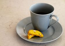 Cup of coffee and some biscotti stock photos