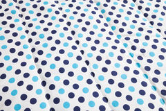 Light blue and dark blue polka dotted quilt Stock Photos