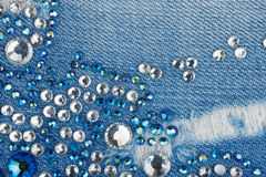 Light-blue denim with blue and silver rhinestones Royalty Free Stock Image