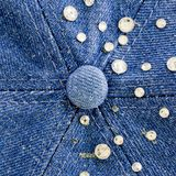 Light-blue denim with blue and silver rhinestones, background. Closeup Light-blue denim with blue and silver rhinestones, background Royalty Free Stock Images