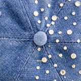 Light-blue denim with blue and silver rhinestones, background Royalty Free Stock Image