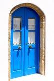 Light blue door with metal handle Stock Images