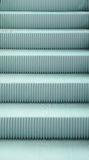 Light blue escalator pattern, close-up step, texture Stock Image