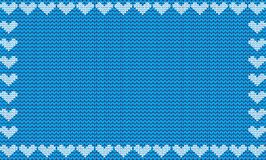 Light blue fabric knitted background framed with knit hearts. Royalty Free Stock Photos