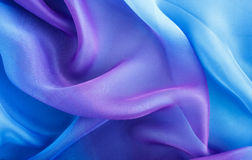 Light blue fabric with large folds Stock Image