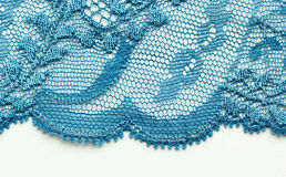 Light blue flowers lace material texture macro shot Royalty Free Stock Photo