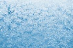 Light blue frozen glass. Light blue frozen window glass Stock Photo