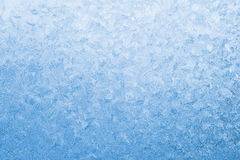 Light blue frozen window glass Royalty Free Stock Images