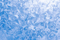 Light blue frozen window glass Stock Photos