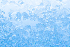 Light blue frozen window glass Stock Photos
