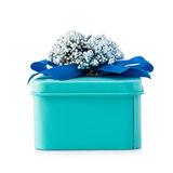 Light blue gift box. With blue ribbon and white flowers isolated on white background. The file includes a clipping path, so it`s easy to work Royalty Free Stock Image