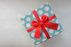 Light blue gift box with white polka dot Royalty Free Stock Photos
