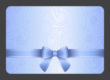 Light blue gift card with ribbon and swirl ornamen Royalty Free Stock Image