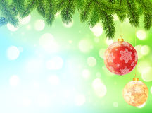 Light blue and green blurred bokeh background with red and yellow Christmas ornament ball Stock Images