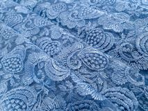 Light blue with grey tone lace background, ornamental flowers. Blue lace fabric pattern, sample, background, wallpaper.ok royalty free stock photo