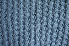 Light blue knitted fabric with relief pattern. From above royalty free stock photos